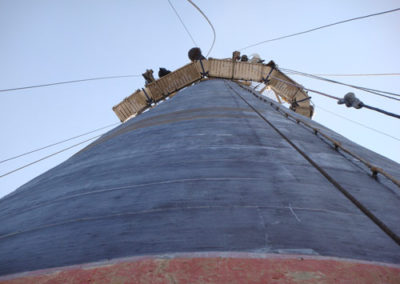 applying carbon fiber wrap to tank