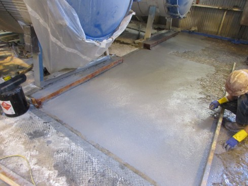 A before and after of a polymer concrete floor