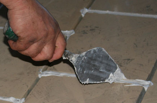 mortar being applied to vitrified tiles